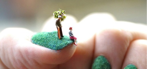 close up miniature people grass landscape