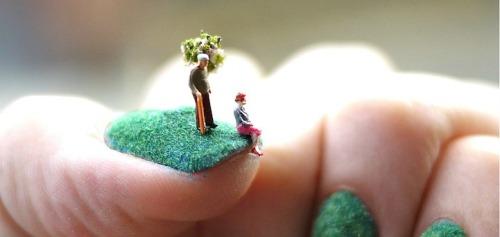 close up miniature people grass landscape